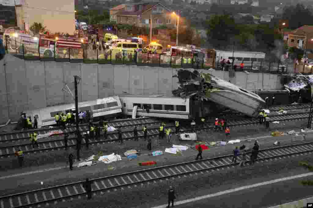 Emergency personnel respond to a train derailment in Santiago de Compostela, Spain, July 24, 2013.