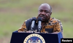 FILE - Gabon's President Ali Bongo addresses reporters at Nairobi National Park near Nairobi, Kenya, April 30, 2016.