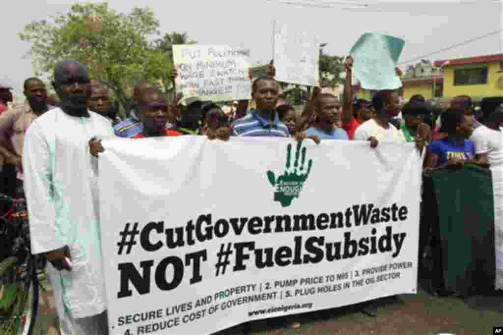 Angry youths protest in front of the National television station on fourth day of the nationwide strike on the removal of a fuel subsidy by the government in Lagos, Nigeria, Thursday, Jan. 12, 2012. A union representing 20,000 oil and gas workers in Niger