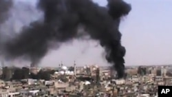 This image made from amateur video provided by the Shaam News Network and accessed Monday, June 18, 2012