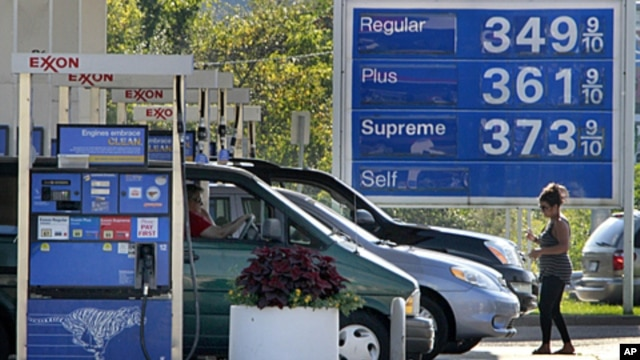 In this September 27, 201 photo, cars line up at the pumps at an Exxon mini-mart in Carnegie, Pennsylvania.