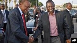 Before departing for AU summit in Addis Ababa, Kenyan President Kenyatta, left, with Deputy President Ruto, Nairobi, Kenya, Oct. 12, 2013.