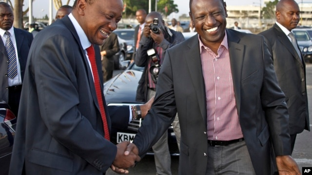 Before departing for AU summit in Addis Ababa, Kenyan President Kenyatta, left, with Deputy President Ruto, Nairobi, Kenya, Oct. 12, 2013.