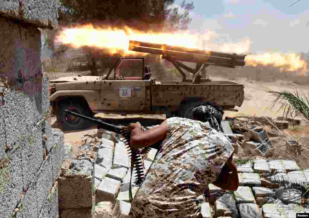 Libyan forces allied with the U.N.-backed government fire weapons during a battle with Islamic State fighters in Sirte, Libya.