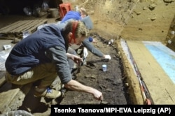 This image provided by Tsenka Tsanova in May 2020 shows excavation work at the Bacho Kiro Cave in Bulgaria.