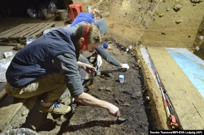 This image provided by Tsenka Tsanova in May 2020 shows excavation work at the Bacho Kiro Cave in Bulgaria.