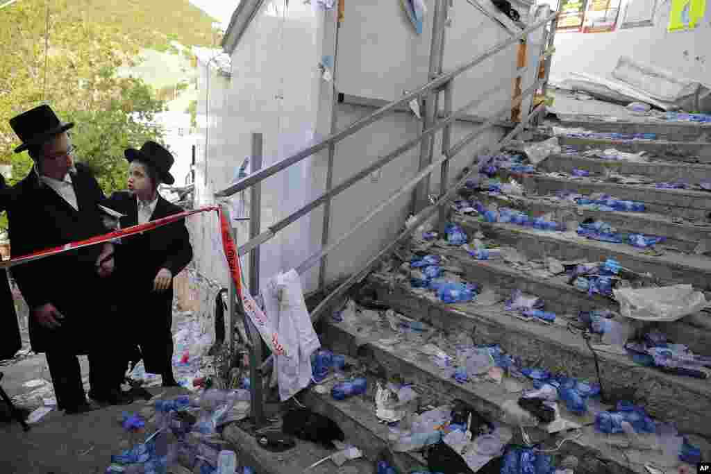 Ultra Orthodox Jews look at the scene where dozens of people were killed and 100s were injured in a stampede attended by tens of thousands of ultra-Orthodox Jews during Lag BaOmer festival at Mt. Meron in northern Israel.