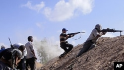 Libyan rebels attack government positions near Tripoli.