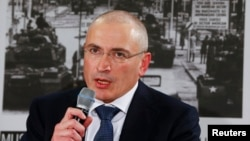 File - Former Russian oil tycoon turned Putin critic Mikhail Khodorkovsky is seen speaking at a news conference in Berlin, Germany, December 2013.