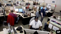 In this 2007 file photo, employees of PayPal work in their cubicles in La Vista, Nebraska.