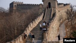 FILE - Visitors walk near a section of the Great Wall of China, north of Beijing, October 28, 2006. (REUTERS/Jason Lee)