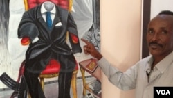 FILE - Somali artist Affey with his painting 'Empty Suit', representing diaspora politicians.