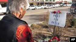 Laura Spaeth visits a memorial honoring slain U.S. hostage Kayla Mueller at the courthouse plaza in Prescott, Arizona, Feb. 10, 2015.
