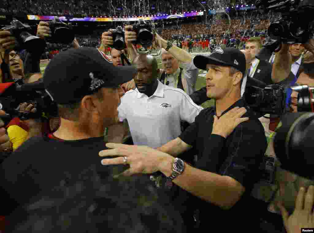 San Francisco 49ers head coach Jim Harbaugh (L) congratulates his brother, Baltimore Ravens head coach John Harbaugh, after the Ravens won in the NFL Super Bowl XLVII football game in New Orleans, Louisiana, February 3, 2013.