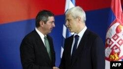 Grčki ministar spoljnih poslova Stavros Lambrinidis i predsednik Srbije Boris Tadić tokom susreta u Beogradu