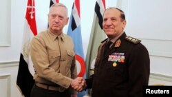 FILE - Egypt's Chief of Staff of the Armed Forces Sami Anan, right, shakes hands with the U.S. Commander of the Central Command James Mattis during a meeting in Cairo, Egypt, March 29, 2011. Anan announced his candidacy for president of Egypt on Saturday.