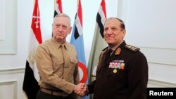 FILE - Egypt's Chief of Staff of the Armed Forces Sami Anan, right, shakes hands with the U.S. Commander of the Central Command James Mattis during a meeting in Cairo, Egypt, March 29, 2011.