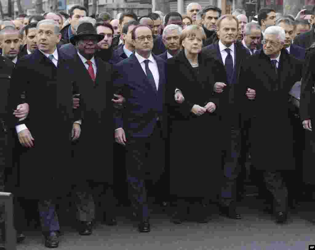 L-R: Israel's Benjamin Netanyahu, Mali's Ibrahim Boubacar Keita, France's Francois Hollande, Germany's Angela Merkel, the EU's Donald Tusk, and Palestinian President Mahmoud Abbas march during a unity rally in Paris January 11, 2014.
