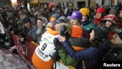 Pete Kaiser of of Bethel, Alaska embraces fans from his hometown after winning the Iditarod Trail Sled Dog Race after crossing the finish line in Nome, Alaska, U.S. March 13, 2019. (REUTERS/Diana Haecker/Nome Nugget)