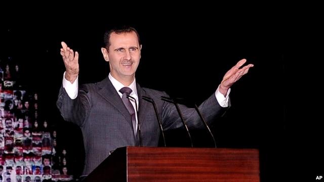 Tổng thống Syria Bashar al-Assad đọc diễn văn đầu tiên kể từ tháng 6 tại nhà hát lớn ở trung tâm thủ đô Damascus, ngày 6/1/2013.