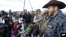 Ammon Bundy, a leader of the occupying protesters at the Malheur National Wildlife Refuge, speaks to reporters during a news conference at the refuge near Burns, Ore., Jan. 6, 2016. (AP Photo/Rick Bowmer)