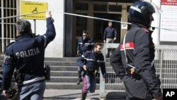 Police activity is seen a courthouse in Milan, Italy, after a shooting was reported inside, April 9, 2015.