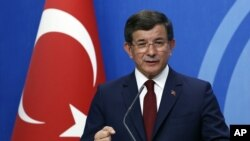 Turkish Prime Minister Ahmet Davutoglu speaks to the media at the headquarters of his ruling Justice and Development Party, AKP, in Ankara, May 5, 2016.