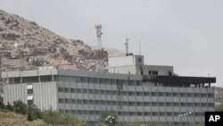 A rear part of the InterContinental hotel that caught on fire has turned to black after it was attacked by militants in Kabul, Afghanistan, June 29, 2011