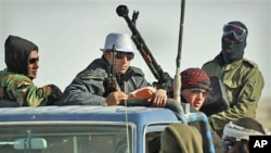 Anti-Gadhafi rebels on an armed truck near Ras Lanuf, eastern Libya, March 7, 2011