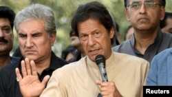 """Pakistani opposition leader Imran Khan talks to media outside his house in Islamabad, Pakistan, Nov. 1, 2016. Instead of a protest, Khan plans a celebration after the Supreme Court's decision to look into the """"Panama Papers."""""""
