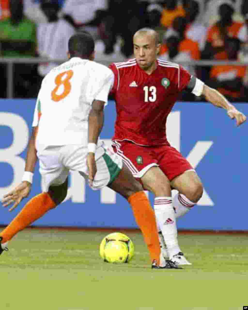 Morocco's Houssine Kharja (13) dribbles the ball against Niger's Harouna Olivier (8) during their final African Cup of Nations Group C soccer match at the Stade De L'Amitie Stadium in Libreville, Gabon January 31, 2012.