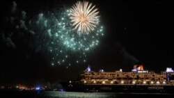 The Queen Mary 2 cruise ship and a fireworks display in New York City.