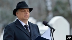 Hungarian Prime Minister Viktor Orban speaks during a ceremony in the Kozma Street Jewish Cemetery in Budapest, Hungary, Jan. 26, 2015.
