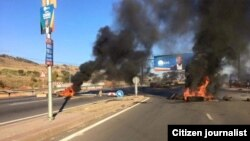 Buses and Haulage Truck burning in South African Political Violence