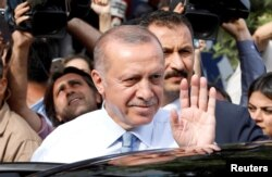 FILE - Turkish President Recep Tayyip Erdogan waves to supporters as he leaves his residence in Istanbul, June 24, 2018.
