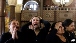 Women cry during the funeral for those killed in a Palm Sunday church attack in Alexandria Egypt, at the Mar Amina church, April 10, 2017. (AP Photo/Samer Abdallah)