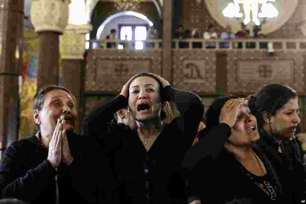 Women cry at the Mar Amina church during the funeral for those killed in a Palm Sunday church attack in Alexandria, Egypt.