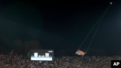 FILE - A drone with an Albanian flag flies over Partizan stadium during the Euro 2016 Group I qualifying match between Serbia and Albania in Belgrade, Serbia, Oct. 14, 2014.