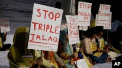 "Activists of various social organizations protest against ""Triple Talaq,"" a divorce practice prevalent among Muslims in New Delhi, India, May 10, 2017."