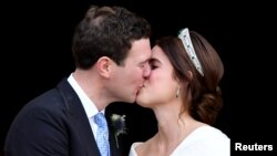 Britain's Princess Eugenie and Jack Brooksbank kiss as they leave after their wedding at St George's Chapel in Windsor Castle, Windsor, Britain Oct. 12, 2018.