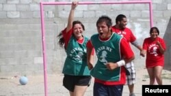 """Youths participating in the """"A Ganar"""" (To Win) program celebrate after scoring a goal during soccer training in Ciudad Juarez June 19, 2014."""
