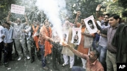 Activists of Bajarang dal, a Hindu rights group, shout slogans and burn firecrackers to celebrate Mohammed Ajmal Kasab's execution, in New Delhi, India, November 21, 2012.