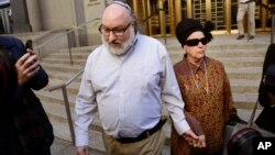 Convicted spy Jonathan Pollard and his wife, Esther, leave the federal courthouse in New York, Nov. 20, 2015. Within hours of his release, Pollard's attorneys began a court challenge to terms of his parole. He served 30 years for selling intelligence secr