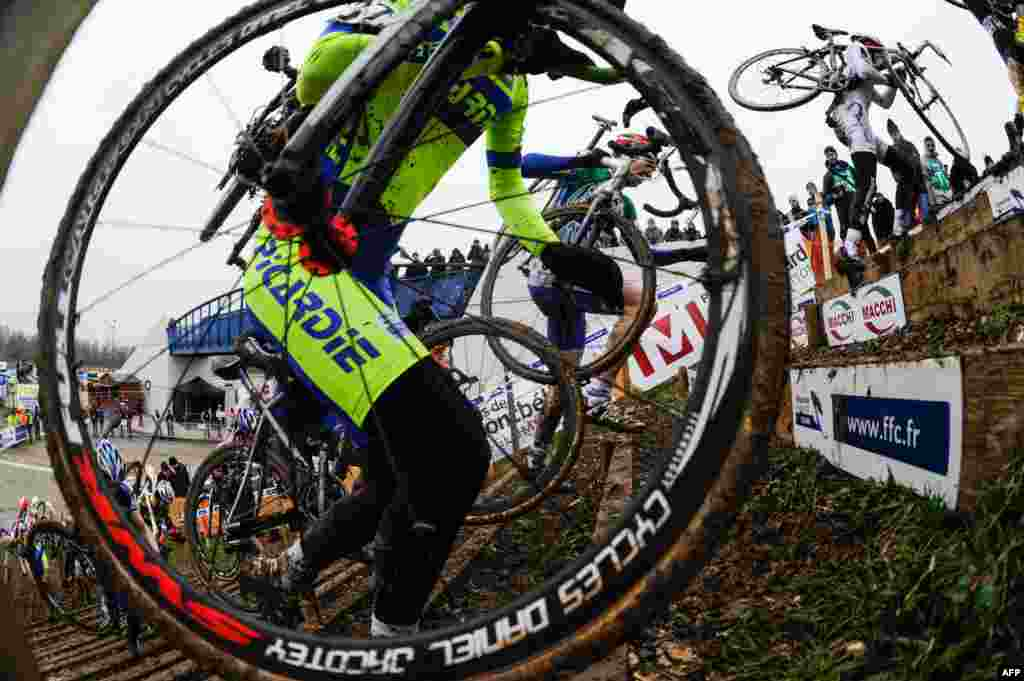 Cyclists compete during the French cyclo-cross championships in Nommay.