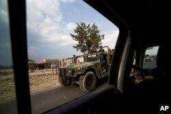 A military convoy patrols a road near Palmarito Tochapan in Puebla State, May 10, 2017.