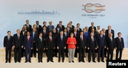 The leaders attending the G-20 summit in Hamburg, Germany, pose for a photo, July 7, 2017.