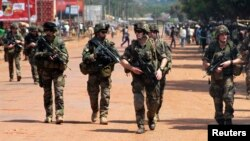 French soldiers are seen patrolling a street in Bangui December 8, 2013.