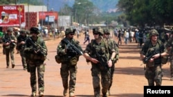 FILE - French soldiers are seen patrolling a street in Bangui.
