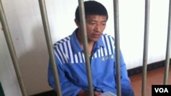 Yonten Gyatso behind bars at an unknown location
