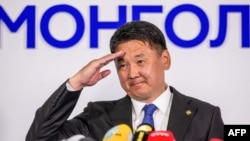 FILE - Mongolia's President Ukhnaagiin Khurelsukh salutes after delivering a speech in Ulaanbaatar, June 9, 2021.